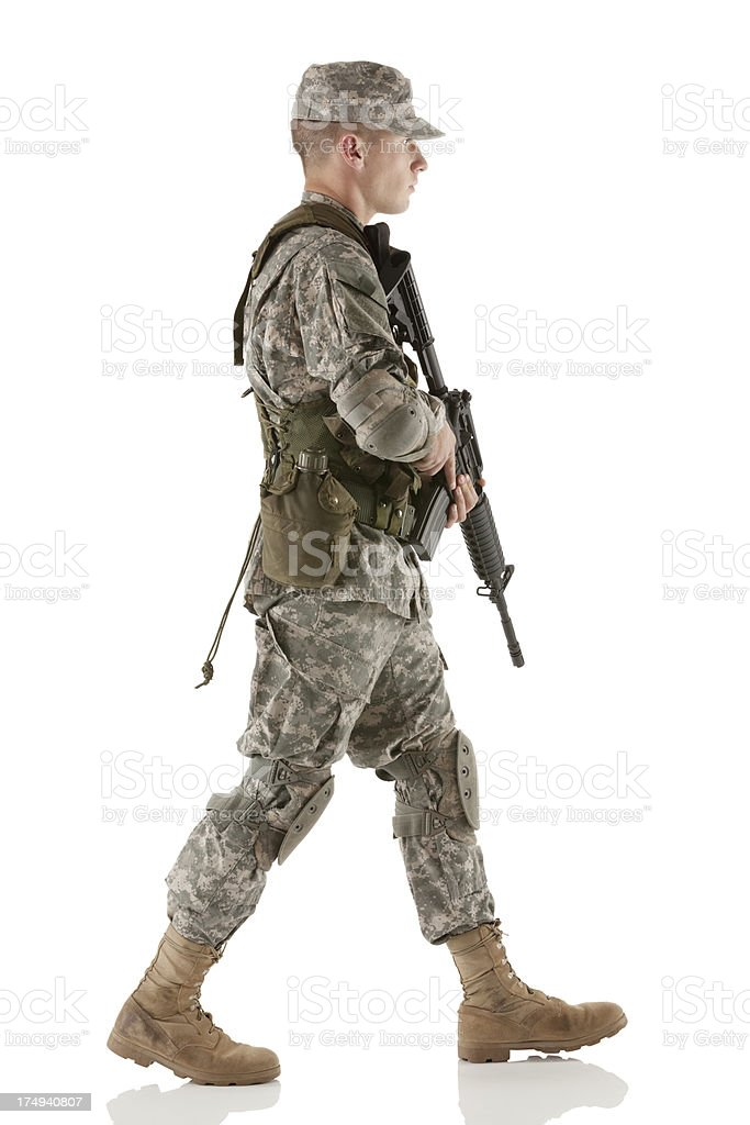 Army soldier carrying a rifle royalty-free stock photo