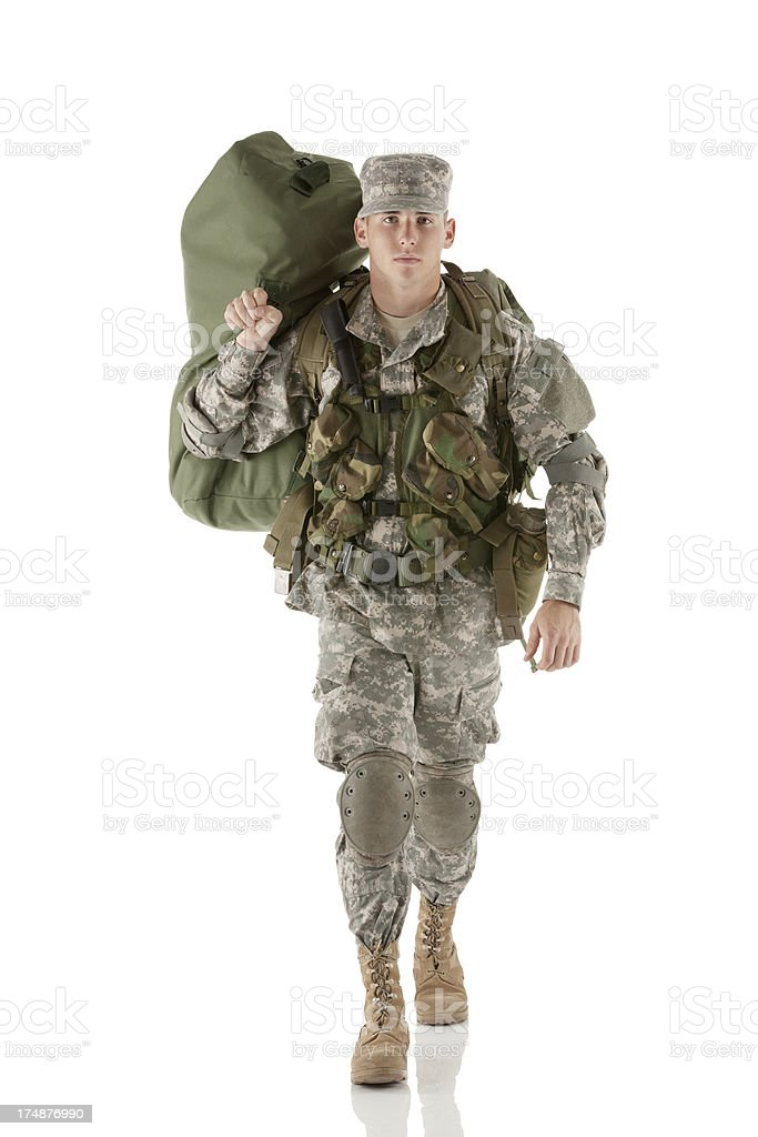 Army soldier carrying his luggage royalty-free stock photo