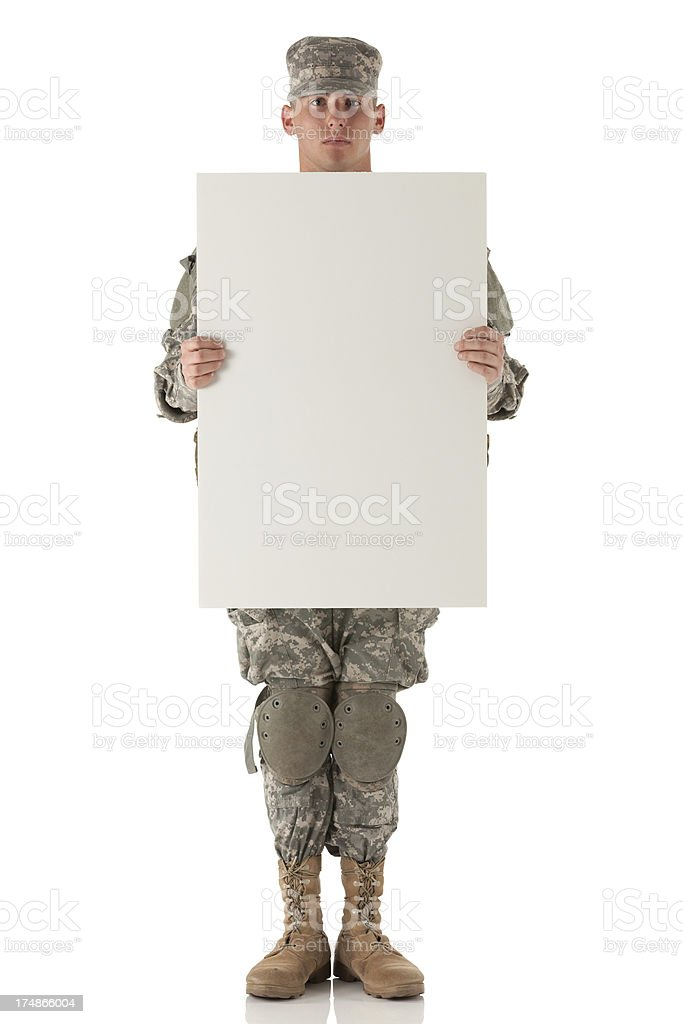 Army soldier holding a placard royalty-free stock photo
