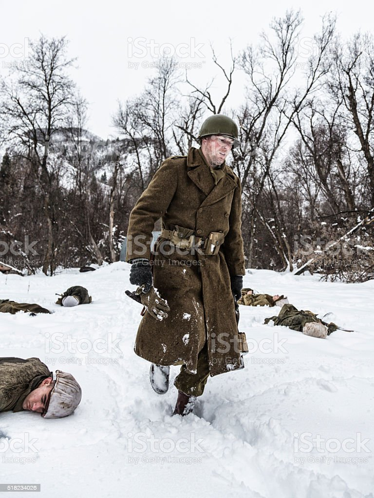 WWII US Army Soldier Leaving Ambush Death Scene stock photo