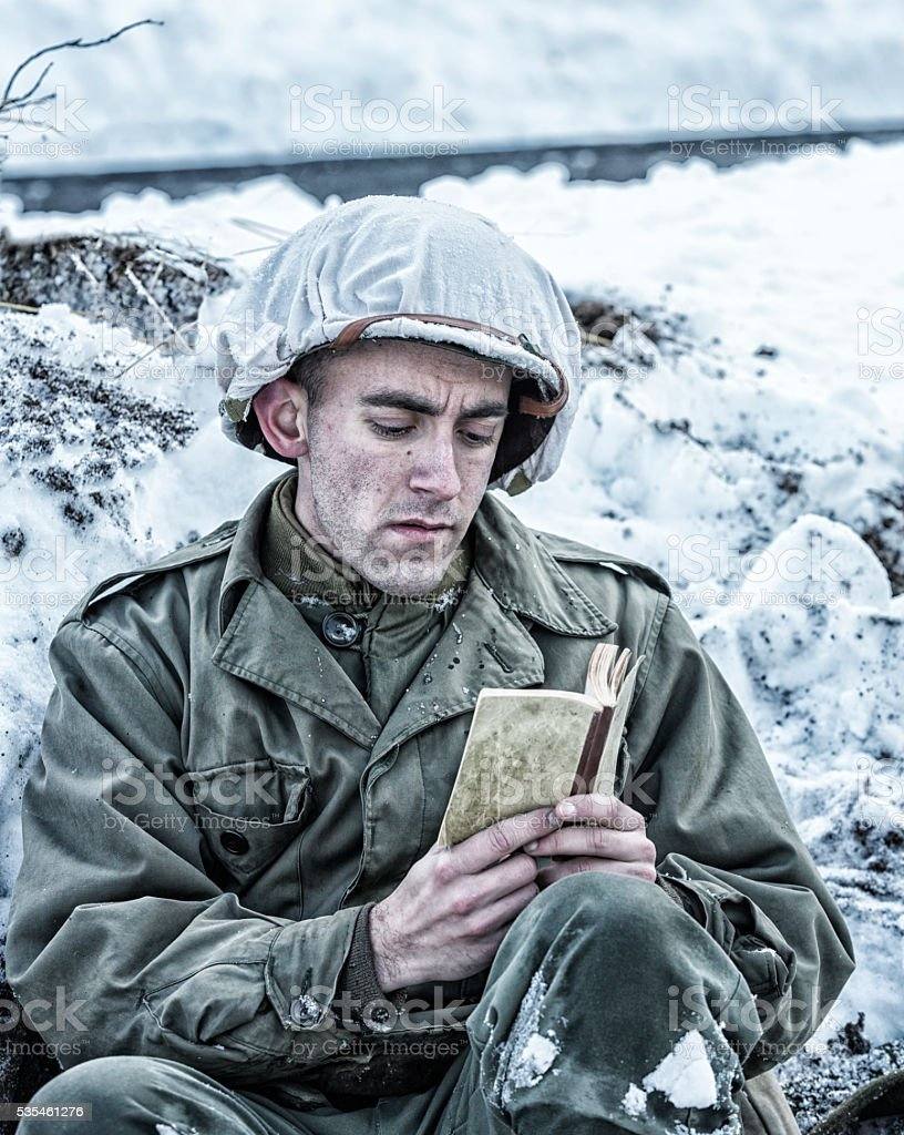 WWII US Army Soldier Memorizing New Testament Bible Scripture stock photo