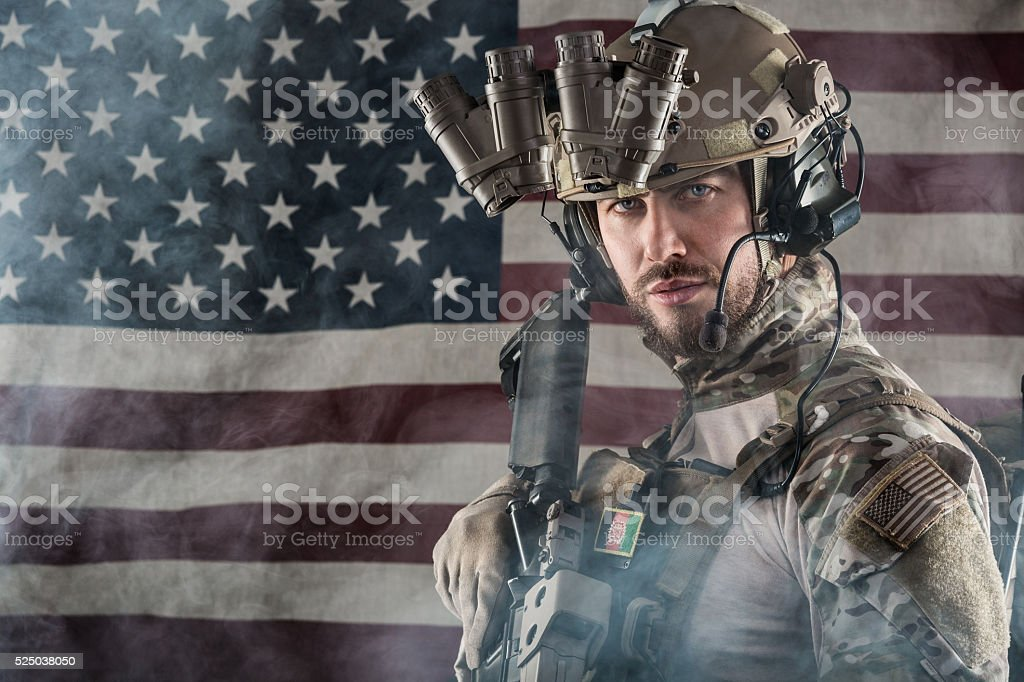 US Army Soldier on American Flag Background stock photo