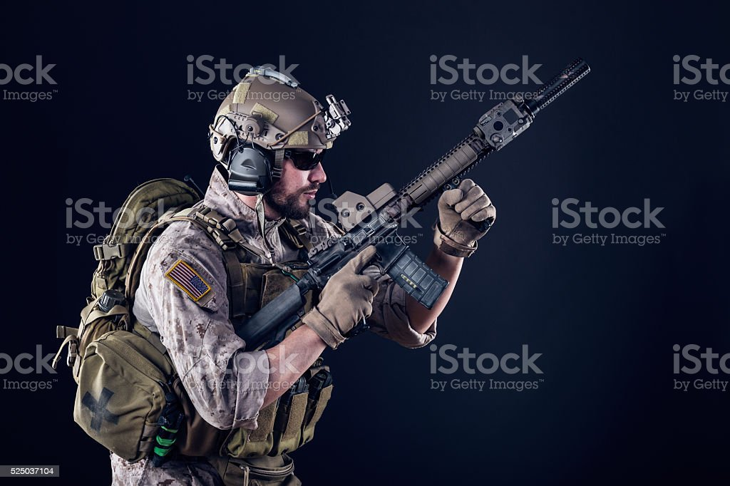 US Army Soldier on Dark Background stock photo
