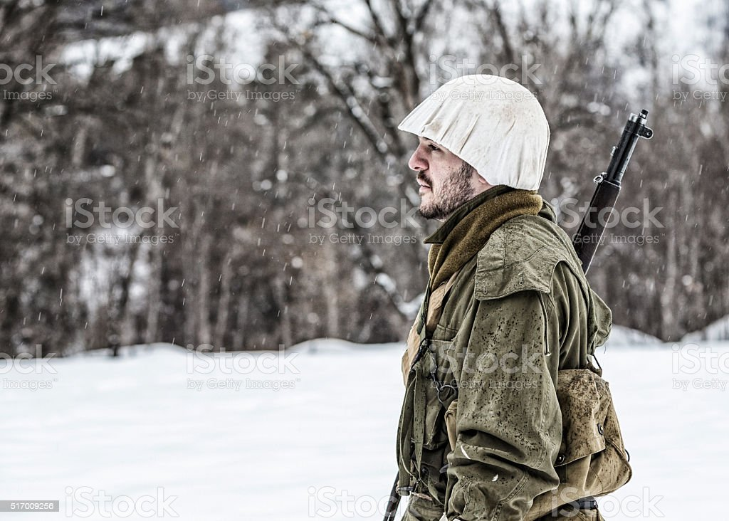WWII US Army Soldier Patrolling Guard in Winter Snow stock photo