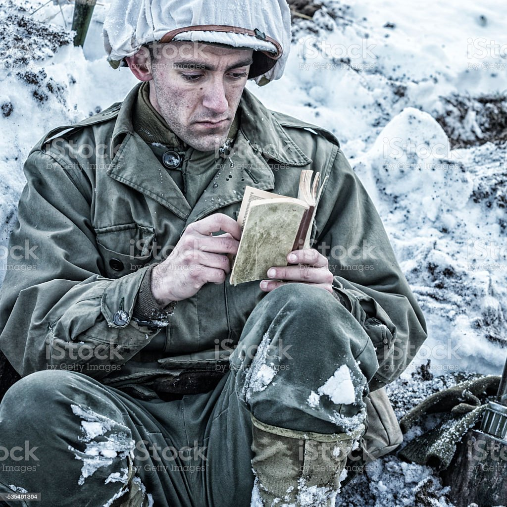 WWII US Army Soldier Reading New Testament Bible Scripture stock photo