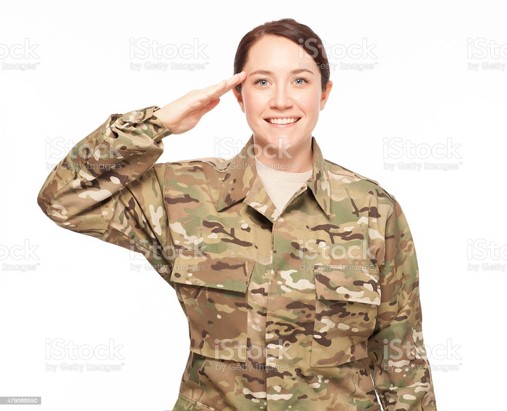 Army soldier saluting and smiling. stock photo