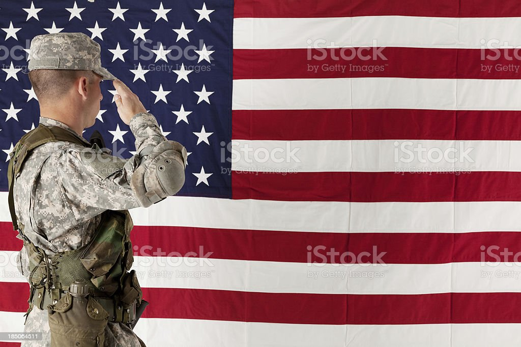 Army soldier saluting US flag royalty-free stock photo