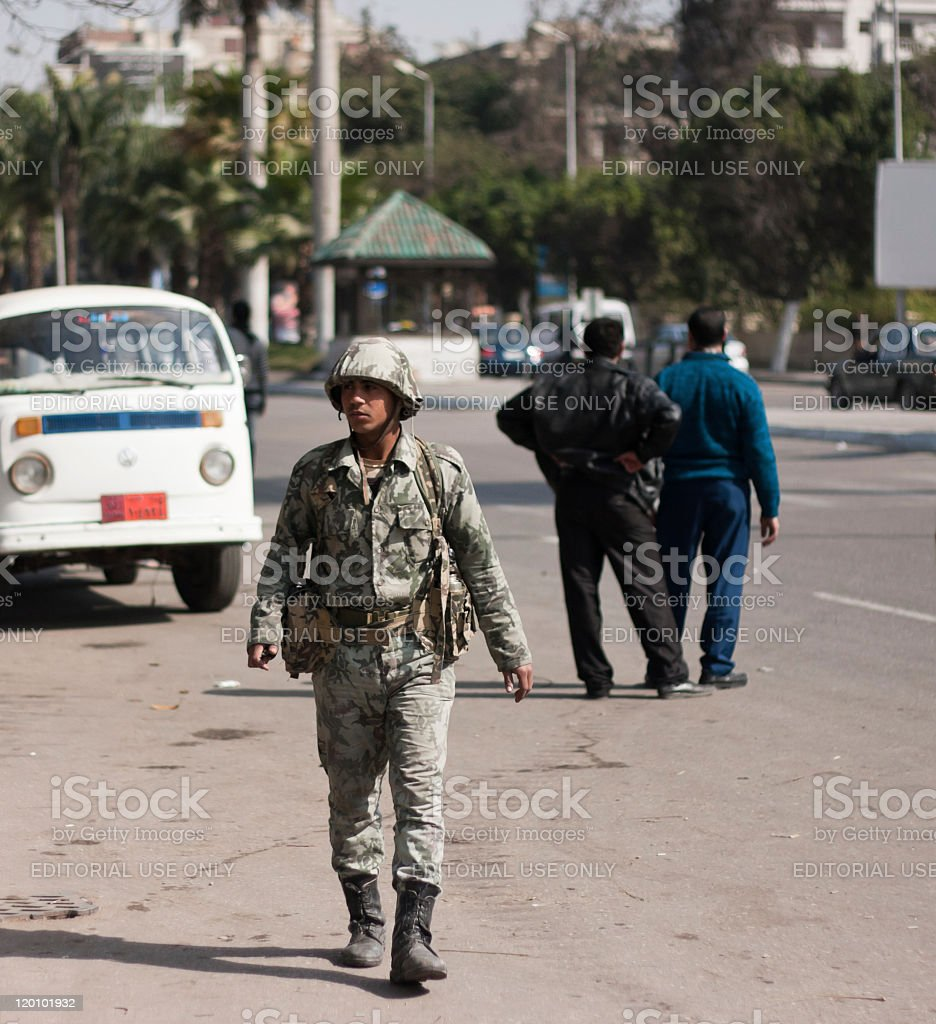 Army soldier walking the streets of Cairo royalty-free stock photo