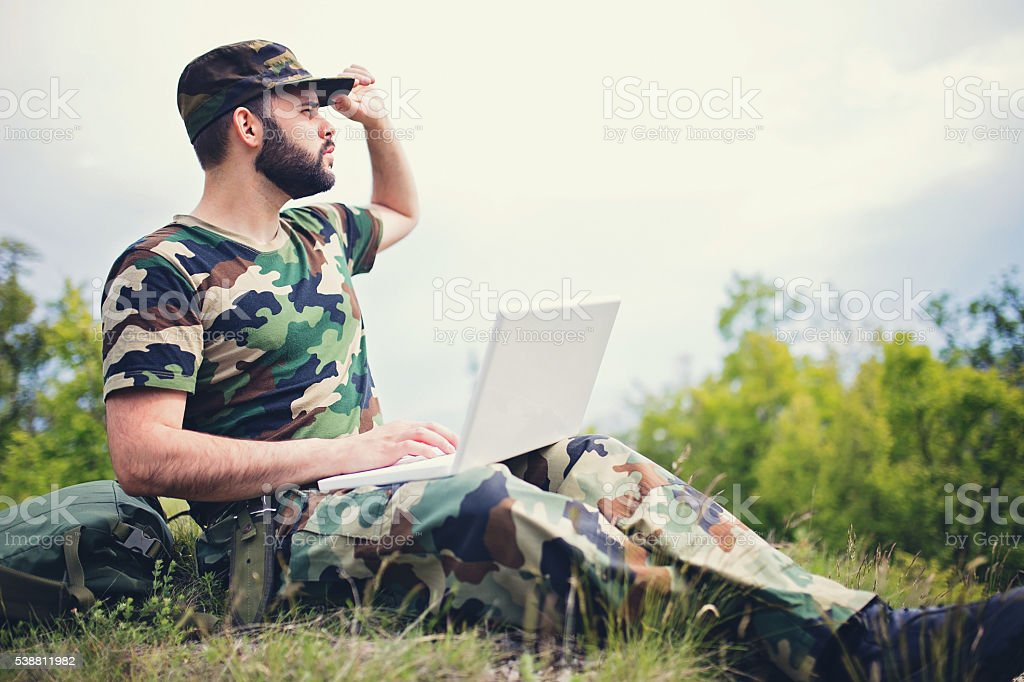 Army soldier with laptop stock photo