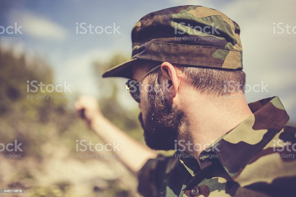 Army soldier with raised fist stock photo