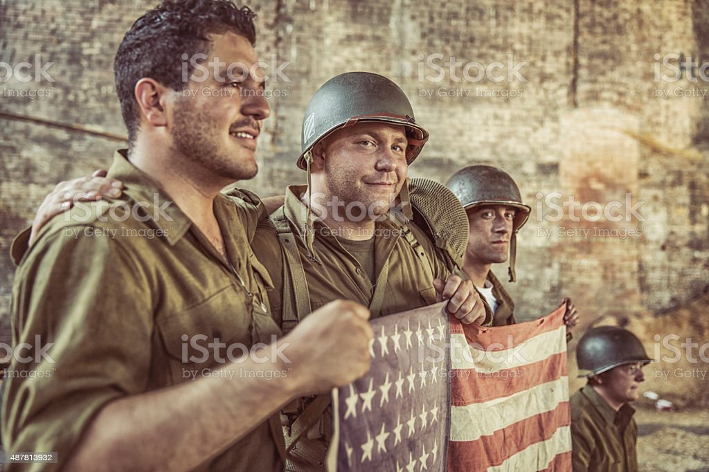 US Army Soldiers Holiding American Flag in Victory stock photo