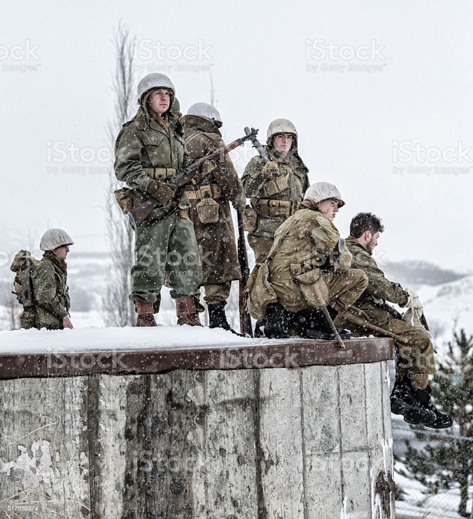 WWII US Army Soldiers Platoon Guarding Concrete Bunker stock photo