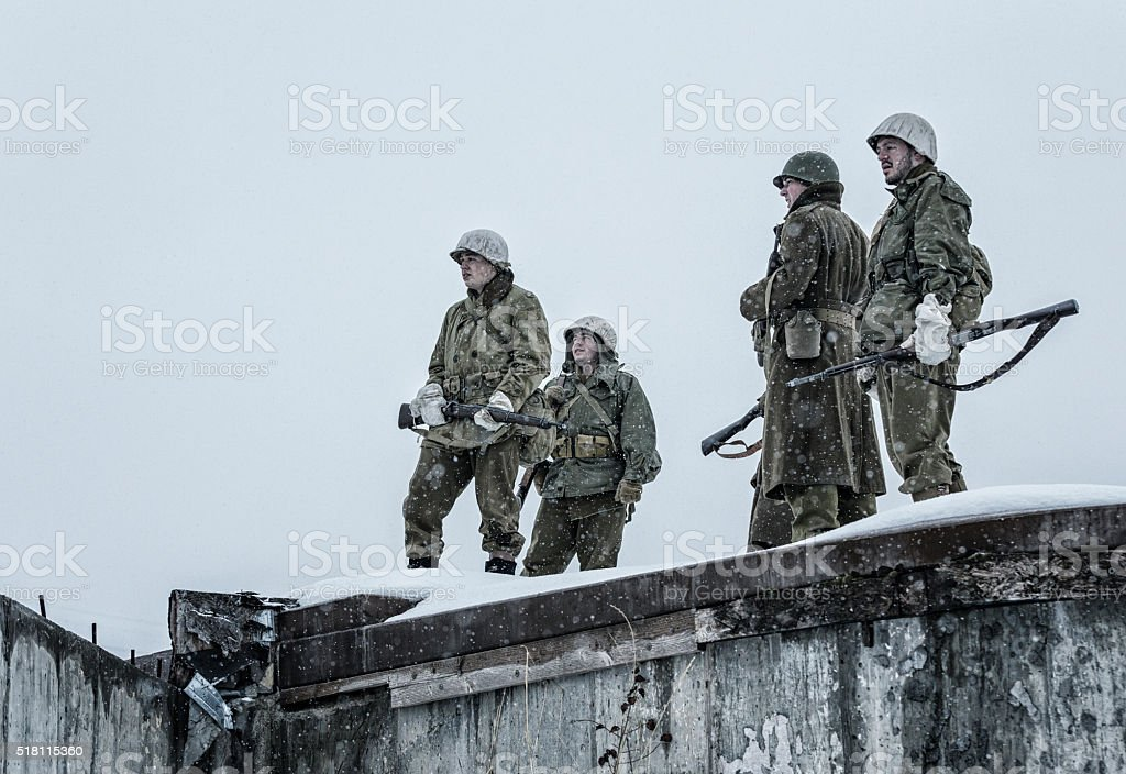 WWII US Army Soldiers Platoon On Burned Out Concrete Bunker stock photo