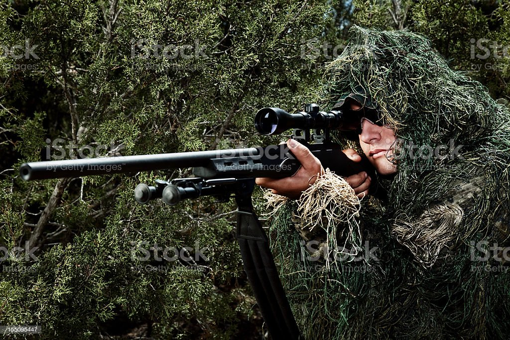 US Army Special Ops Military Soldier in Camouflage Ghillie Suit stock photo