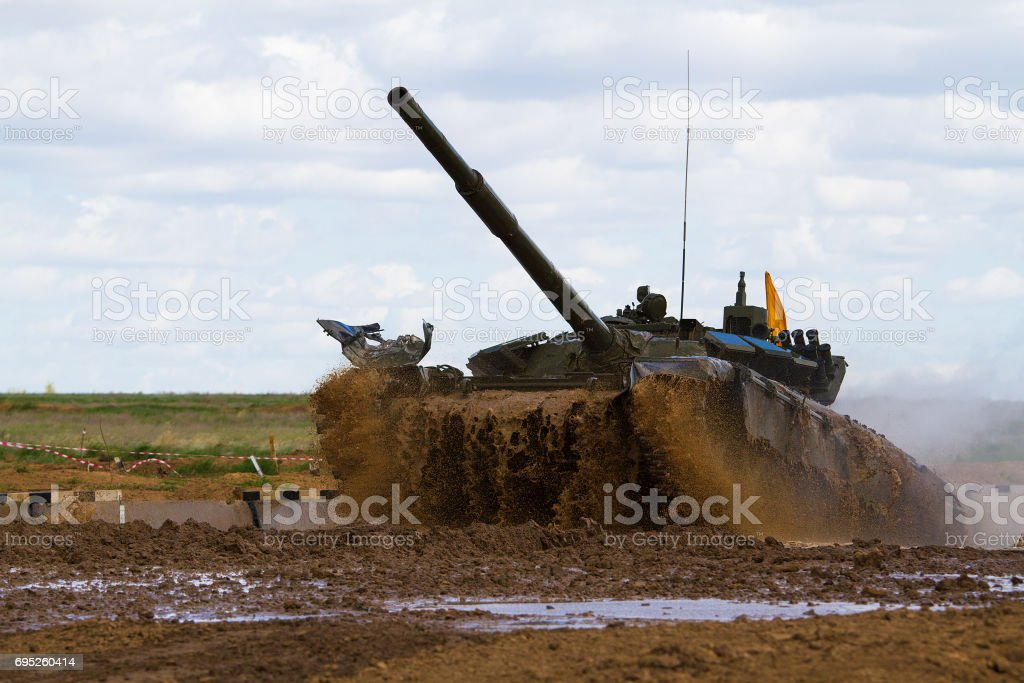 Army tank crosses the water obstacle stock photo