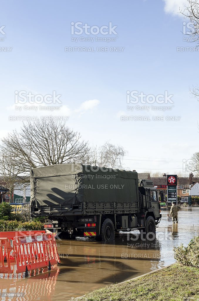 Army truck drives down flooded road royalty-free stock photo