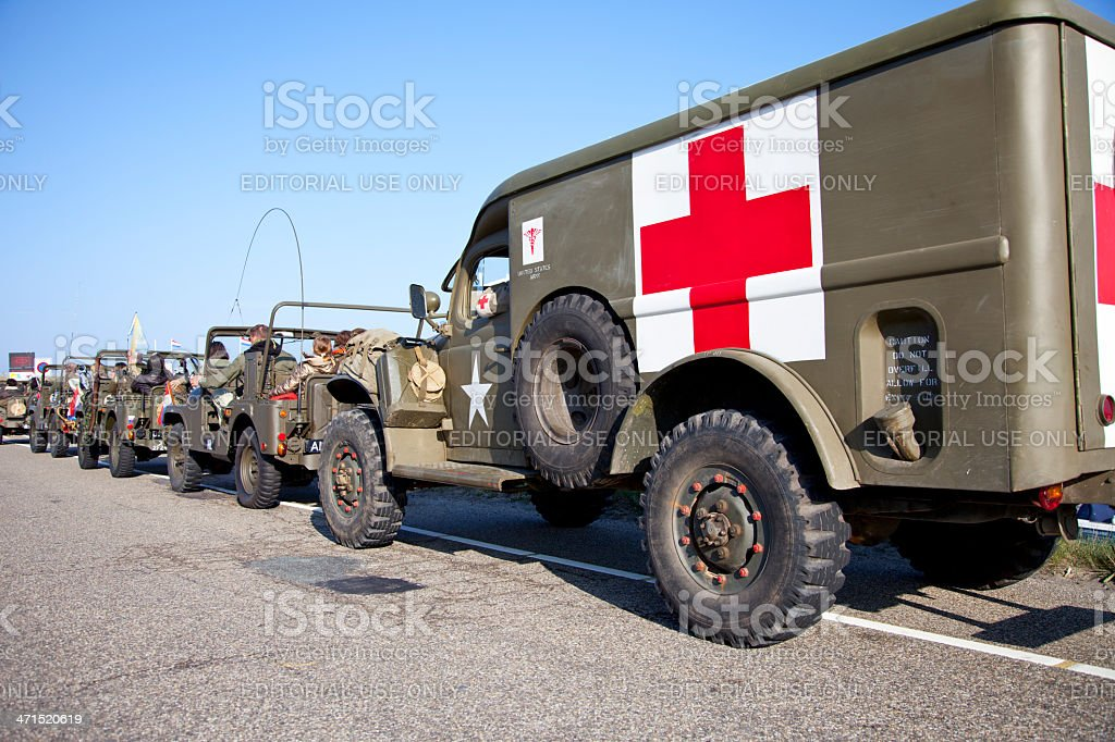 Army trucks of organization Kelly's Heroes riding on beach royalty-free stock photo