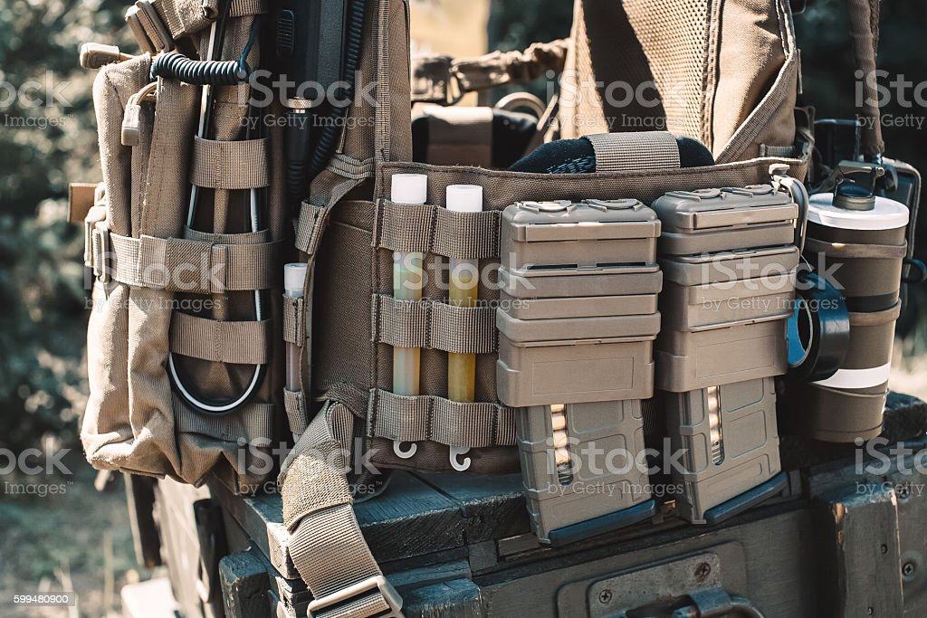 Army vest standing on a wooden box of ammunition. stock photo