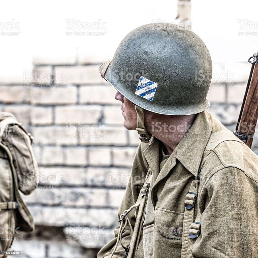 US Army World War II Combat Soldier Waiting For Orders stock photo