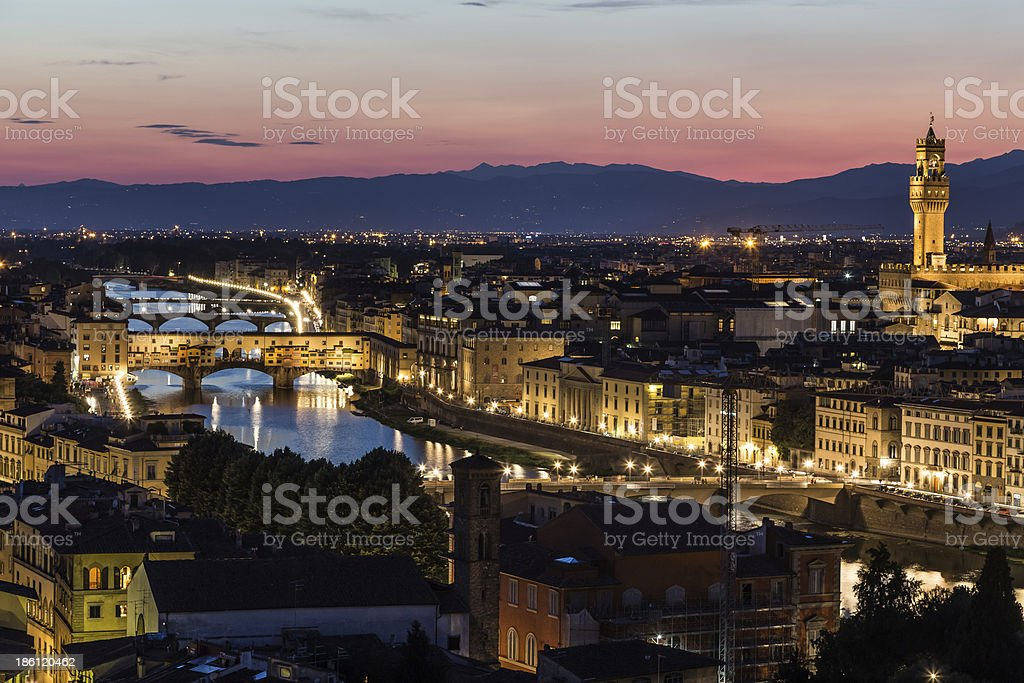 Arno river and Ponte Vecchio in Florence at night royalty-free stock photo
