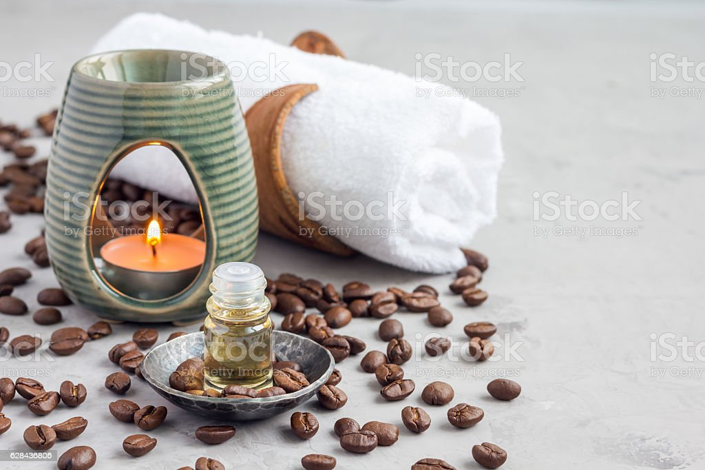 Aroma lamp with coffee essential oil, spa background, horizontal stock photo