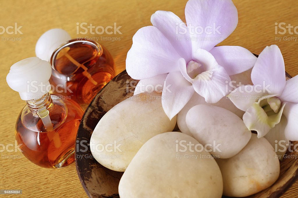 Aroma oils with orchid flowers royalty-free stock photo