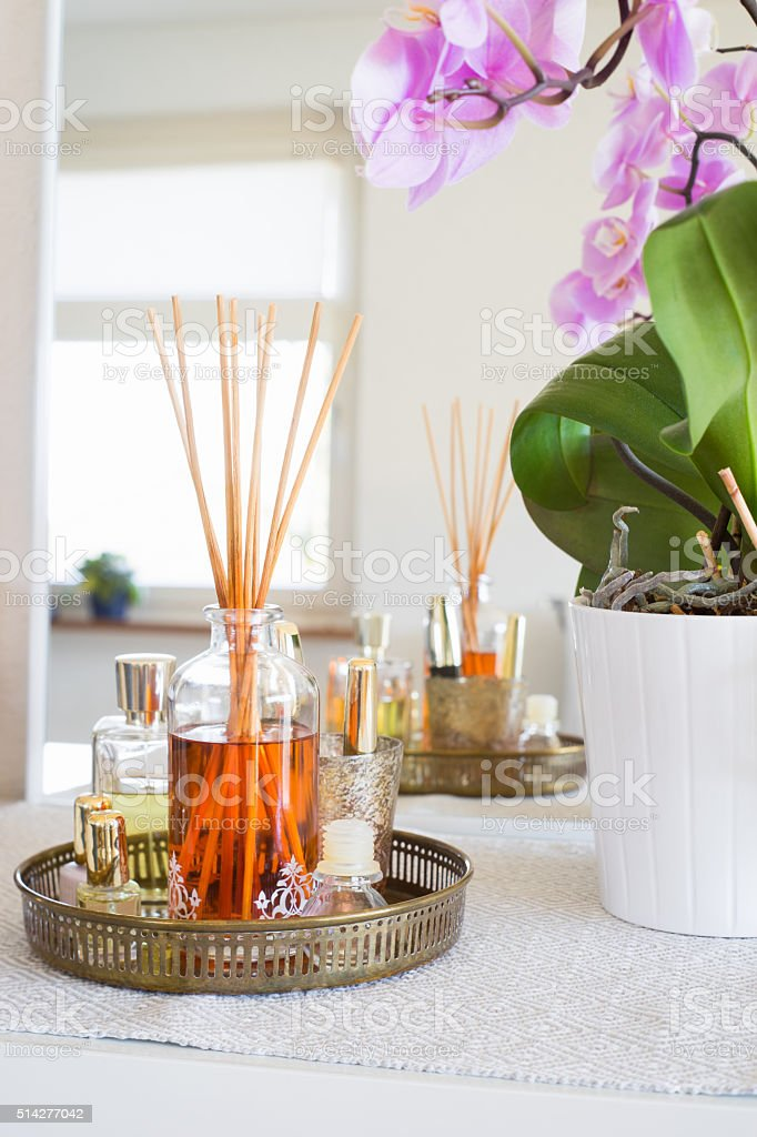 Aroma reed diffuser in home interior stock photo
