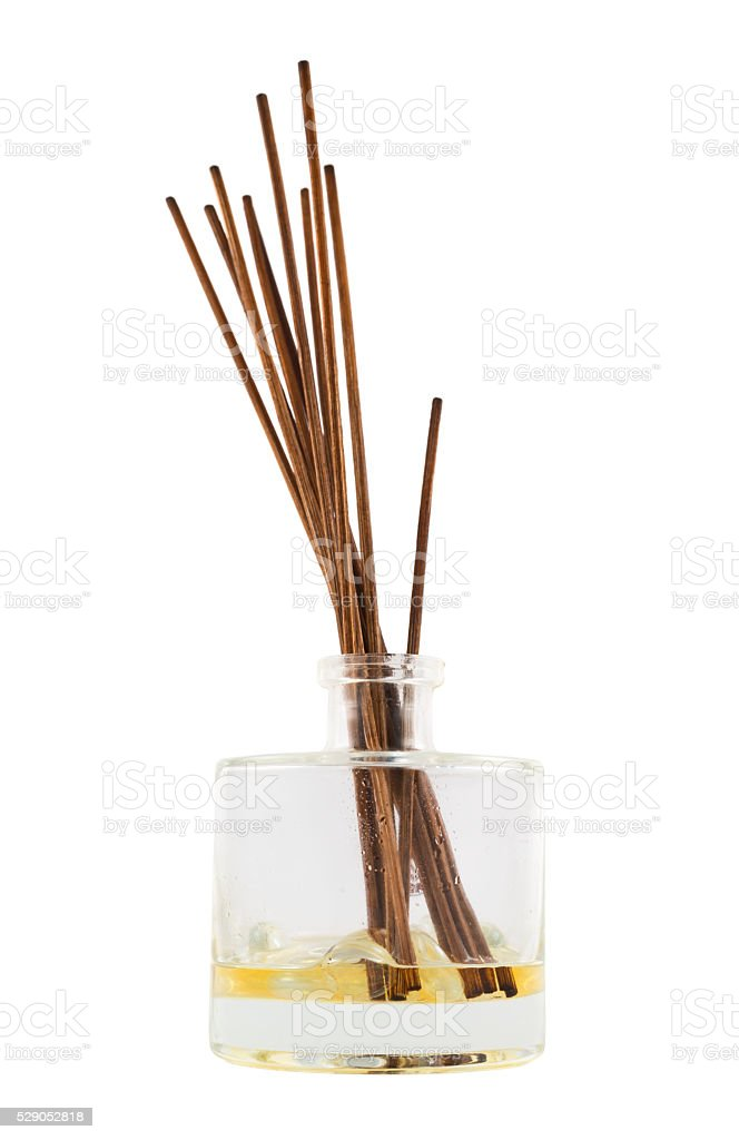 Aroma sticks in a glass flask isolated stock photo