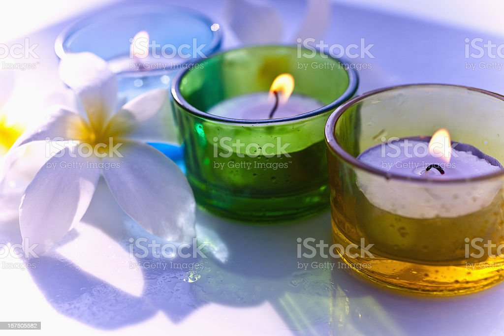 Aromatherapy candle and flowers royalty-free stock photo