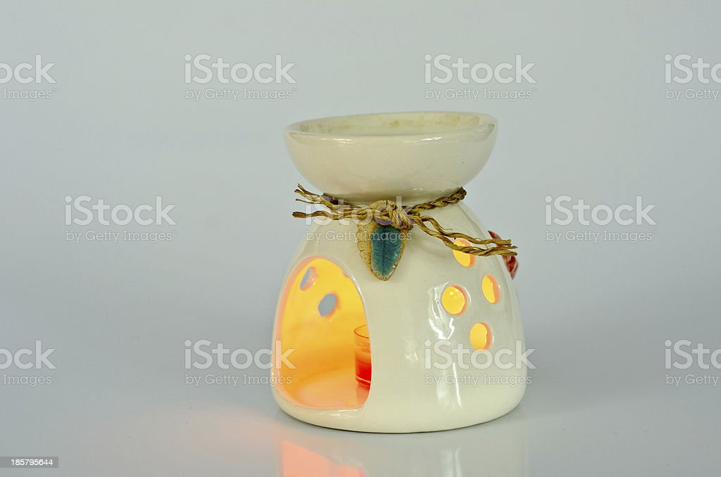Aromatherapy lamp isolated on white royalty-free stock photo