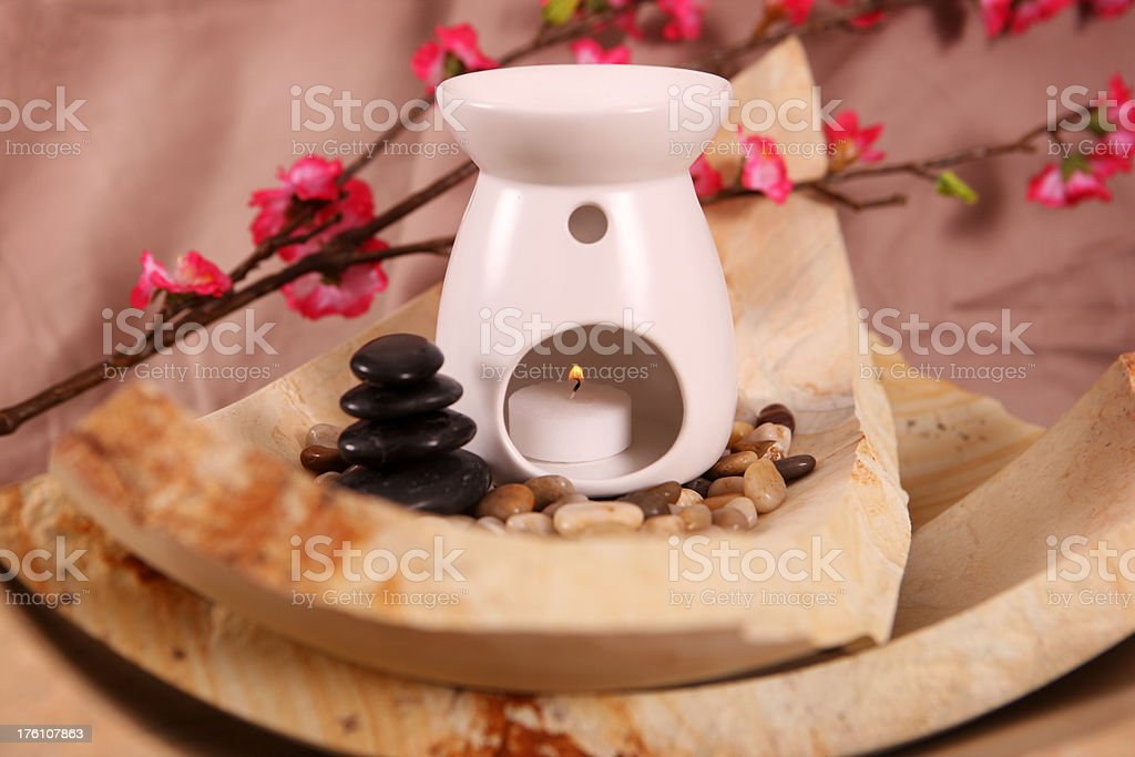 Aromatherapy oil burner on top of sandstone royalty-free stock photo