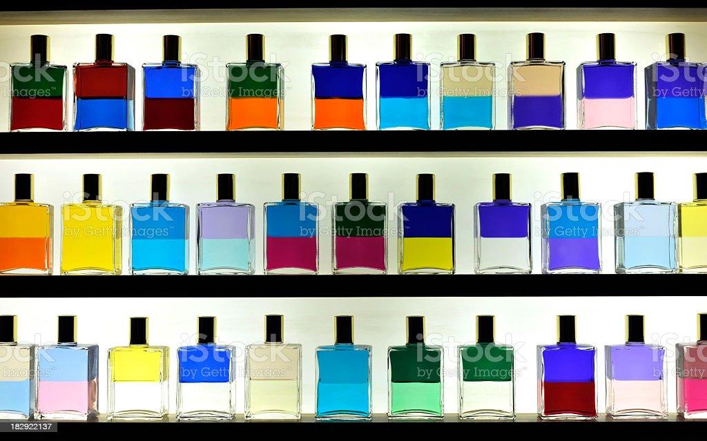 Aromatherapy oils standing on a shelf. stock photo