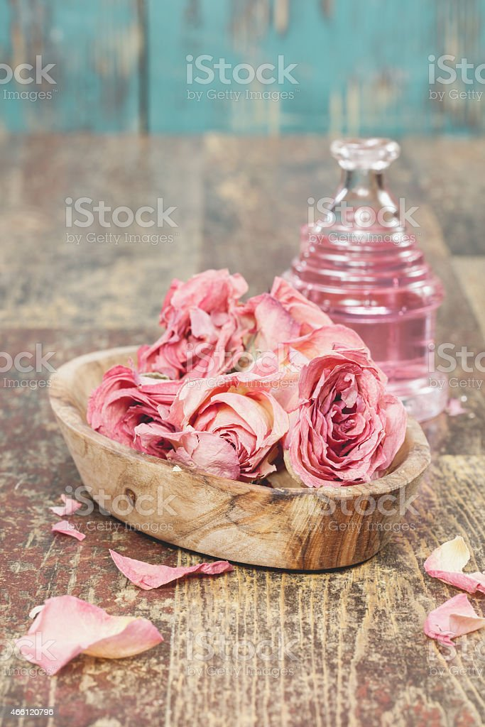 Aromatherapy rose oil for massage on wooden table stock photo