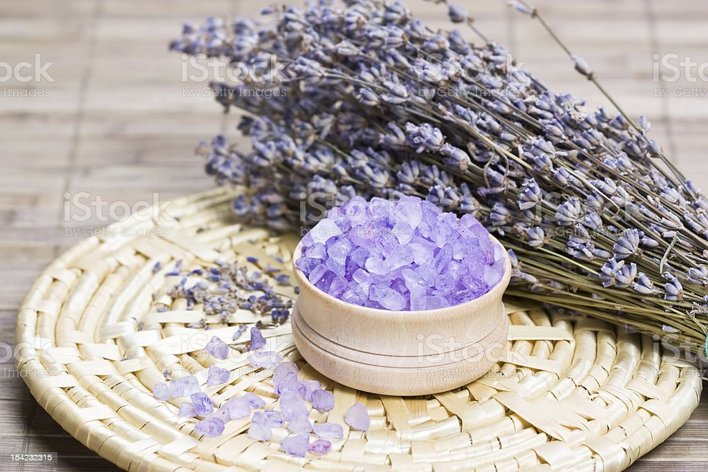 Aromatic bath salt and dry lavender flowers royalty-free stock photo