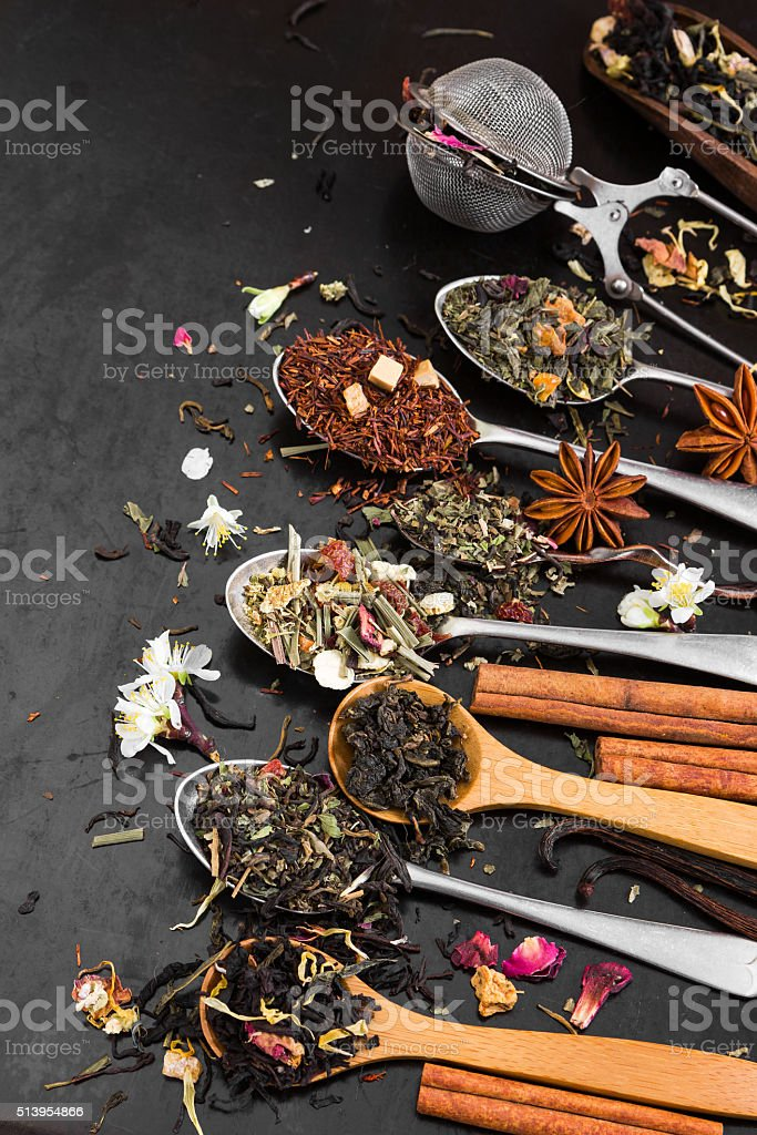 Aromatic flower tea in spoon. Top view. stock photo
