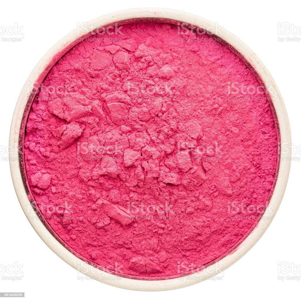 aronia berry powder in a round bowl, stock photo
