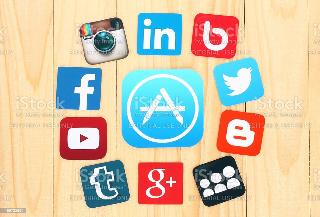 Around AppStore icon are placed famous social media icons stock photo