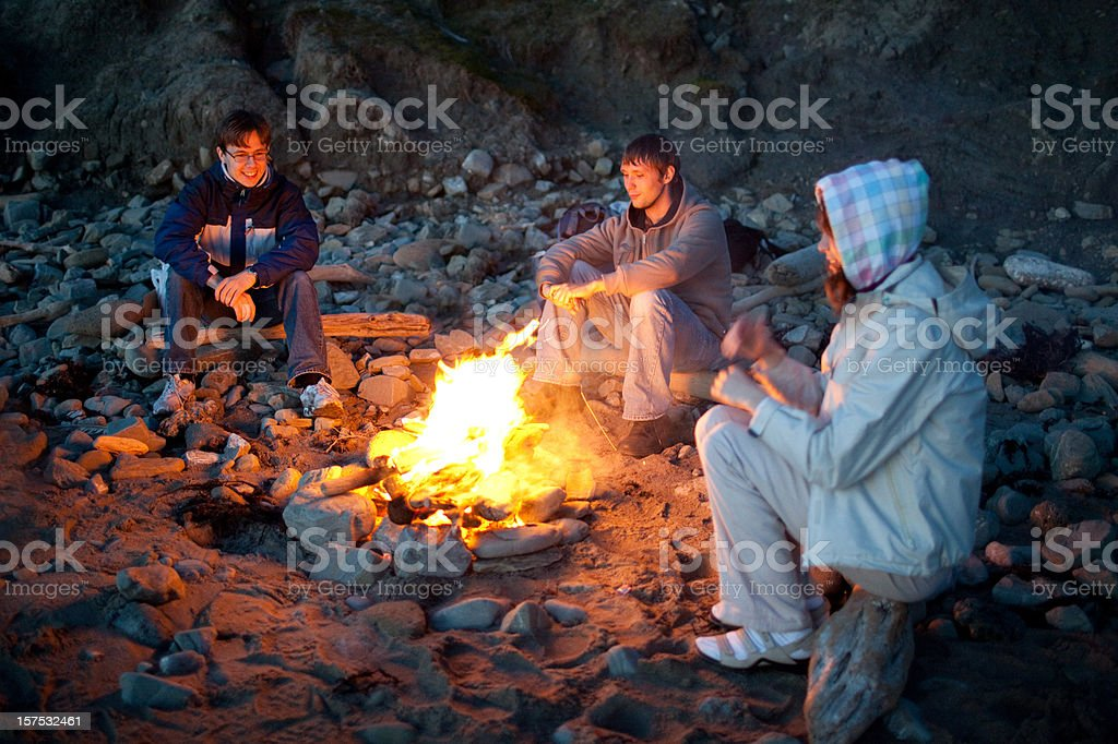 Around campfire royalty-free stock photo