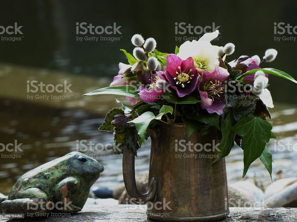 Around our pond -  The Frog and the Easter bouquet... stock photo