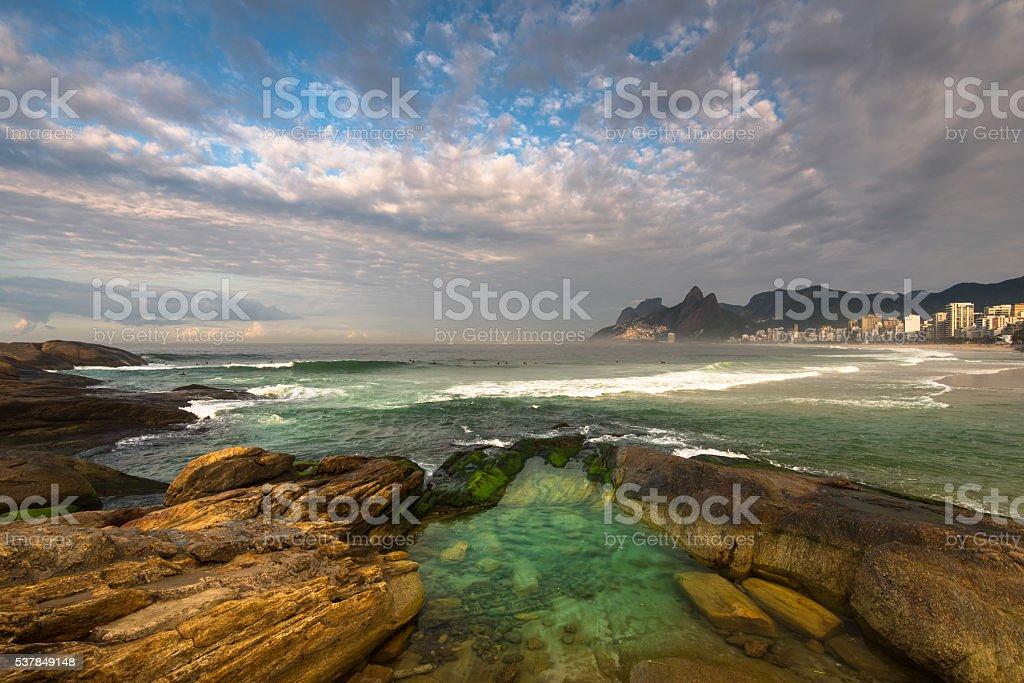 Arpoador Beach Rocks and Dramatic Sky Above Rio de Janeiro stock photo