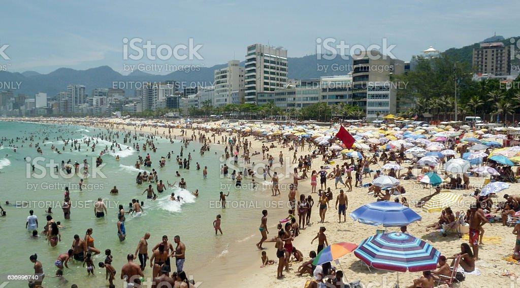 Arpoador beach with bathers and umbrellas stock photo