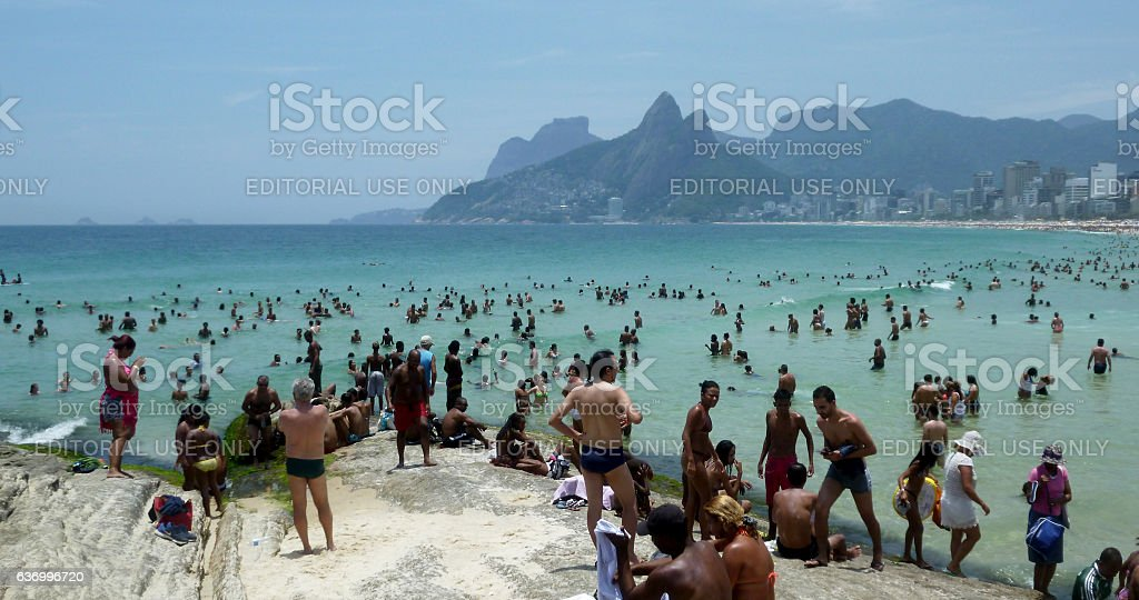 Arpoador beach with crowd and emerald waters stock photo