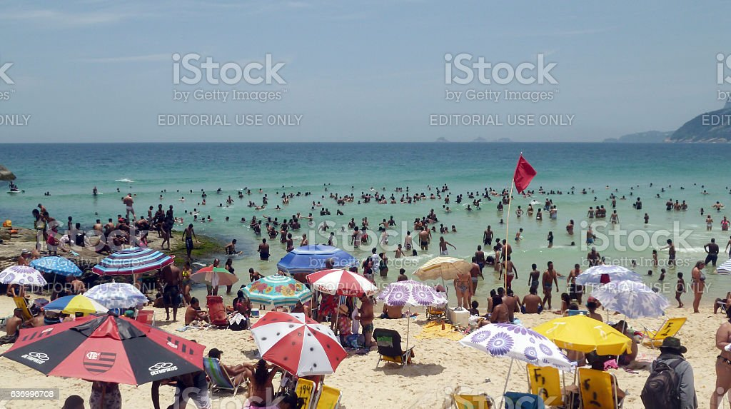 Arpoador beach with crowd on a 40 degree day stock photo