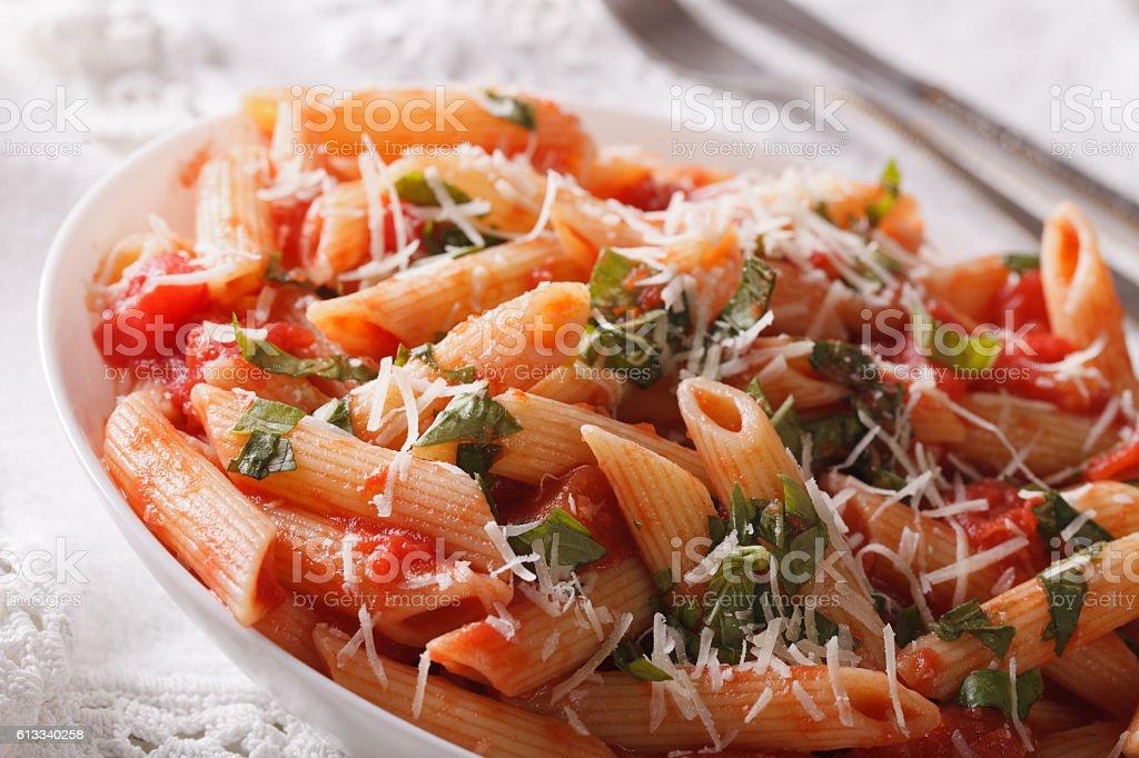 Arrabiata Pasta with Parmesan on a plate macro. horizontal stock photo