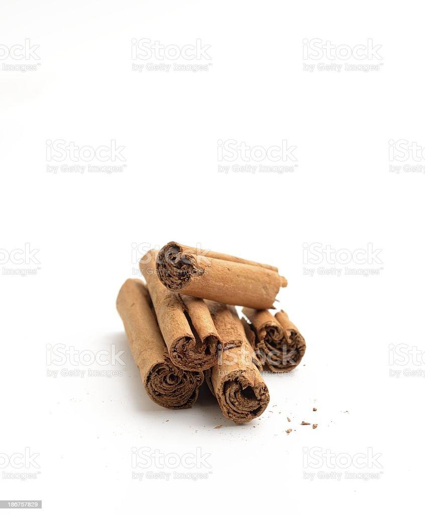 Arrangement of cinnamon sticks front view royalty-free stock photo