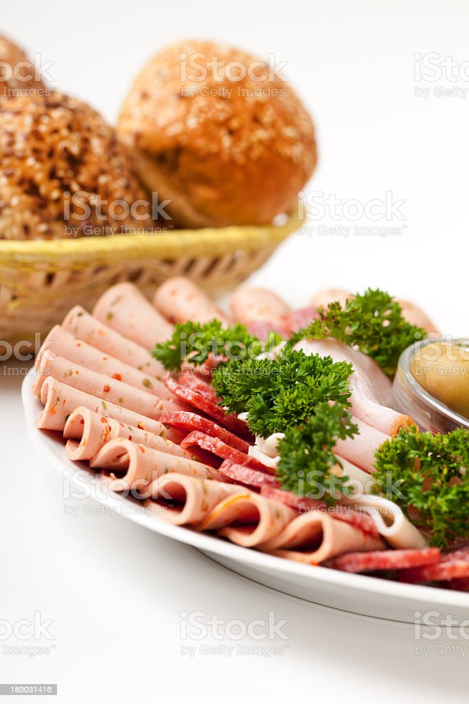 Arrangement of cold meat on plate stock photo