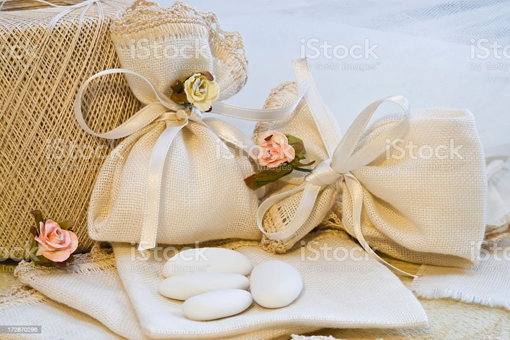 Arrangement of cream and rose colored wedding favors royalty-free stock photo