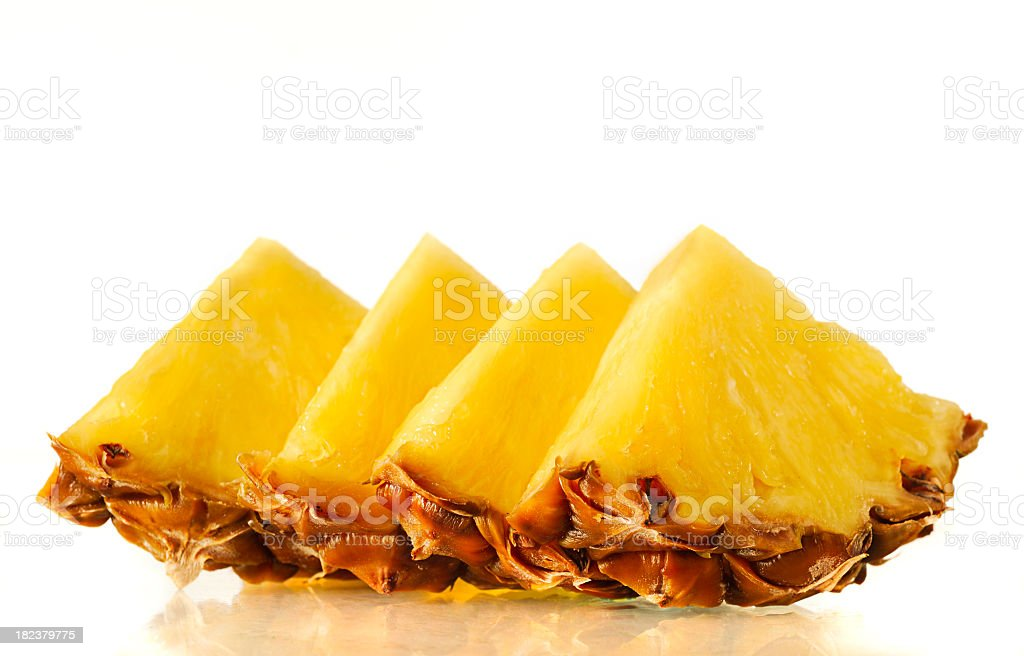 Arrangement of fresh slices of pineapple royalty-free stock photo