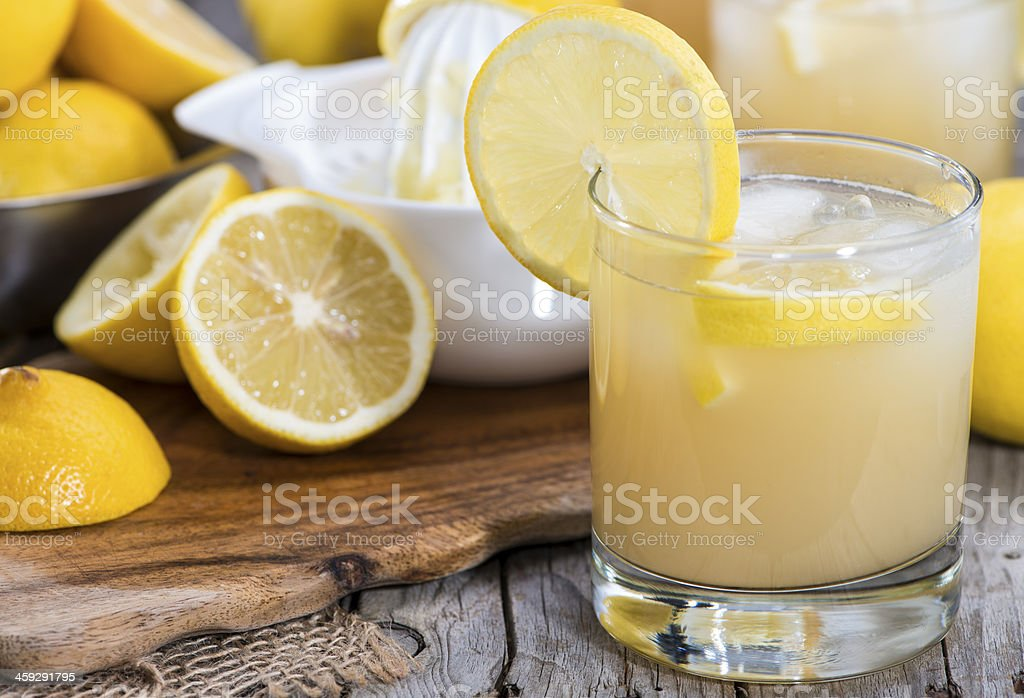 Arrangement of glass with fresh lemonade with ingredients stock photo