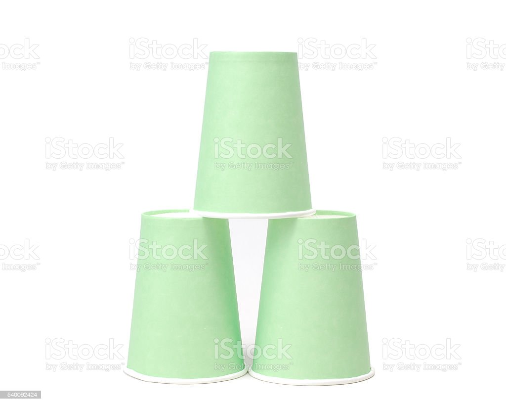 Arrangement of green recycling paper glasses on white background stock photo